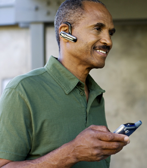 Man wearing cell phone headset.