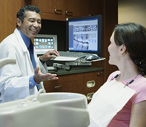Dentist talking to patient.