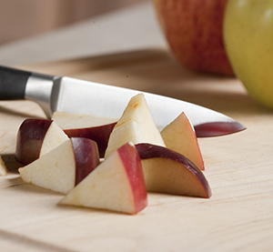 Knife and apple pieces.
