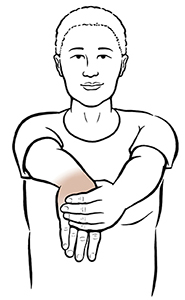 Woman doing wrist flexion exercise.