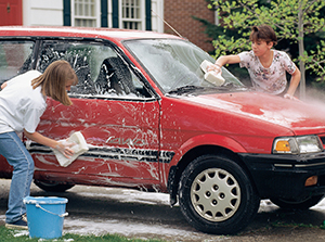 Teens washing car.