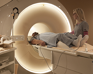 Technician preparing man for MRI scan.