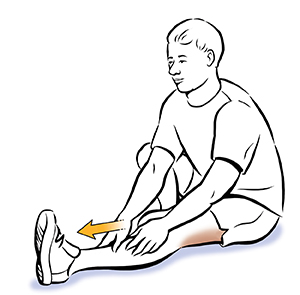 Seated man doing hamstring stretch.