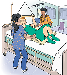 Two healthcare providers moving patient up in hospital bed.