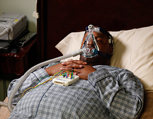 Man in bed undergoing sleep study.