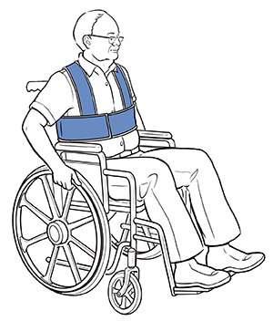 Man sitting in wheelchair with safety straps around waist and shoulders.