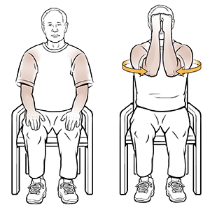 Man sitting in chair doing shoulder isometric exercise.