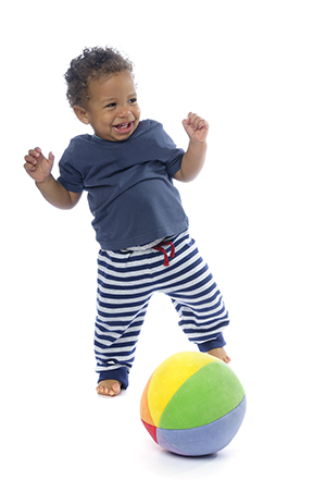 Happy baby playing with a ball.