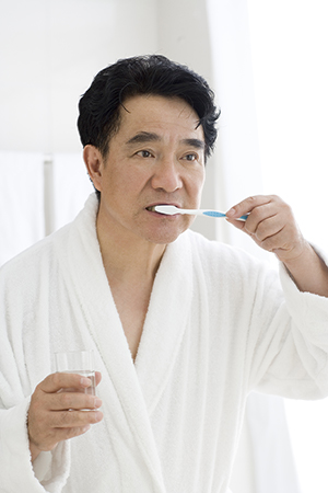 Woman brushing her teeth.