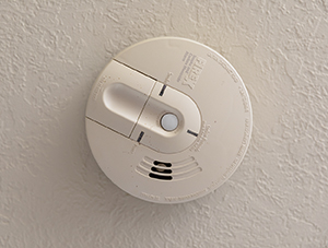 Smoke and carbon monoxide detector on ceiling.